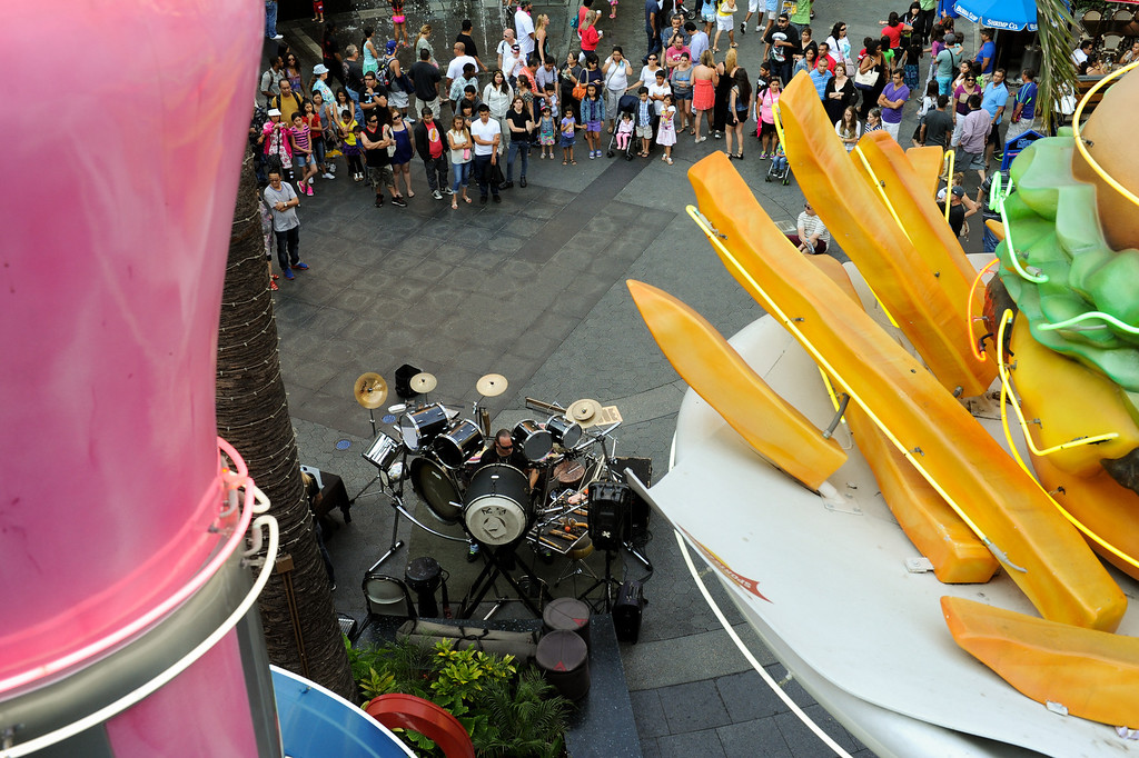 . C.G. Ryche performs drums as part of the street performer series at Universal CityWalk. Friday, July 6, 2013. (Michael Owen Baker/L.A. Daily News)