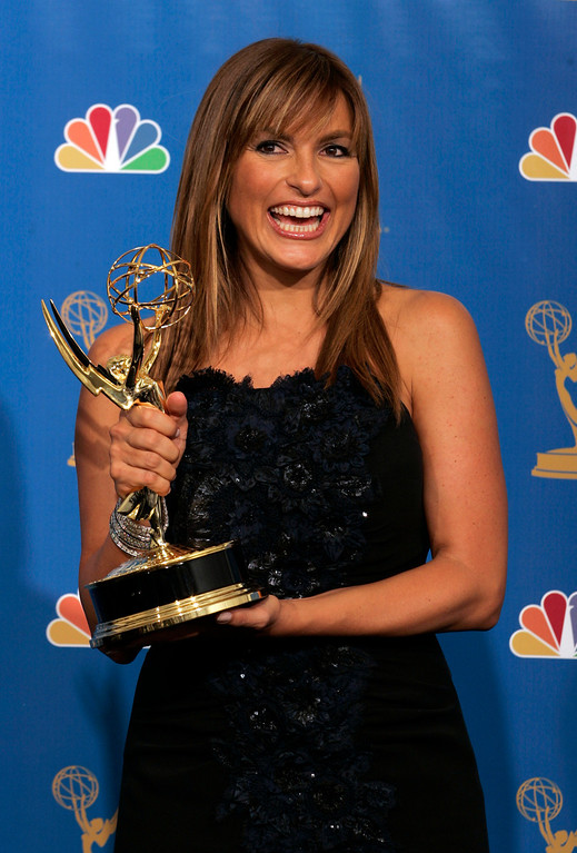 ". Mariska Hargitay holds the award for outstanding lead actress in a drama series for her work on ""Law & Order: Special Victims Unit\"" at the 58th Annual Primetime Emmy Awards Sunday, Aug. 27, 2006, in Los Angeles. (AP Photo/Reed Saxon)"