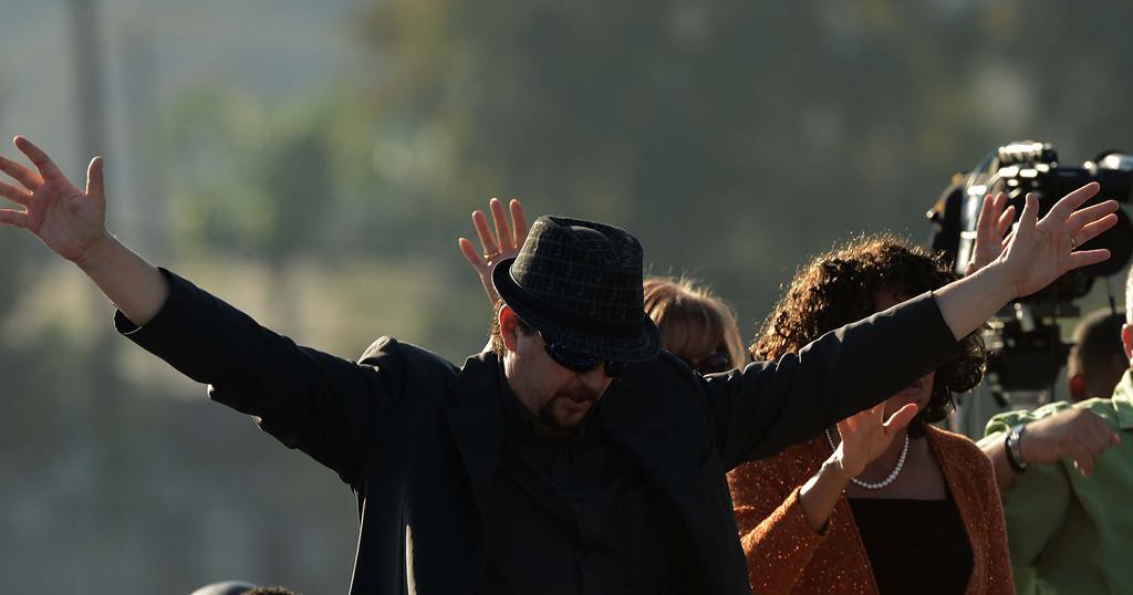 . David Berg, 45, of Las Angeles came to praise the lord  at the Pomona Day Of Prayer Sunday November 10, 2013 at Ganesha High School Nancy McCracken stadium in Pomona.LaFonzo Carter/ Staff Photographer