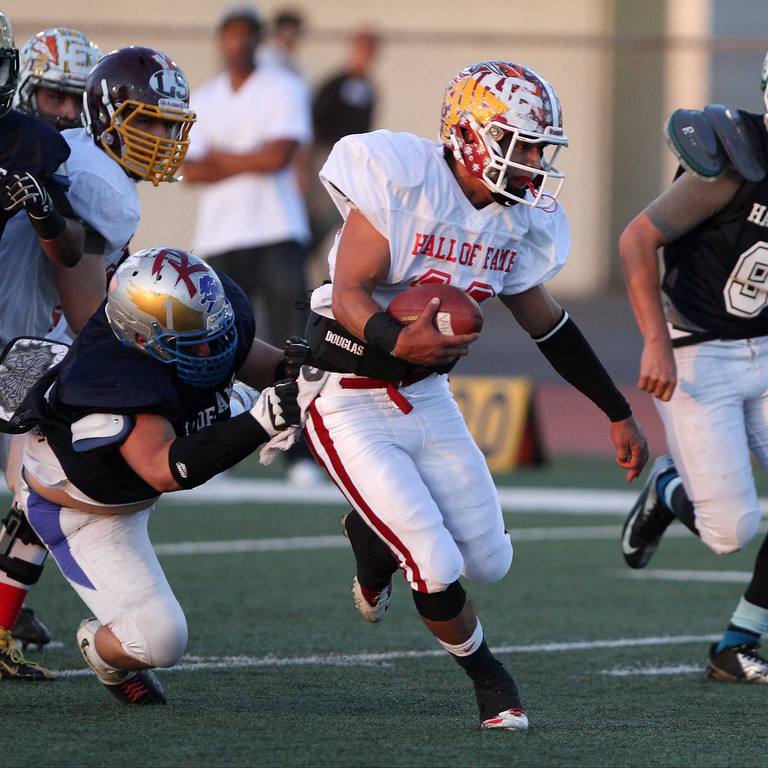. La Serna\'s Frankie Palmer (19) runs for yardage during the 35th Annual Hall of Fame All-Star Football Game at West Covina High School in West Covina, CA on Friday, May 16, 2014. (SVGN/Correspondent Photo by David Thomas/SPORTS)