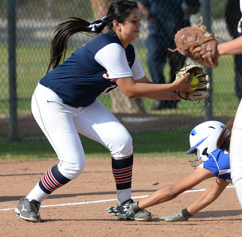 . St. Paul third baseman Sydney Kreimann (#18) tags out Bishop Amat\'s Alyssa Barrera (#16) at third base in their Del Rey League girls softball game at York Field in Whittier on Thursday March 27, 2014. St. Paul defeated Bishop Amat 7-5. (Staff Photo by Keith Durflinger/Whittier Daily News)
