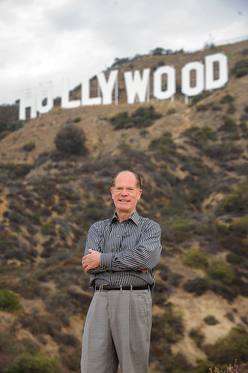 . Chris Baumgart, chairman of the Hollywood Sign Trust, shows off the Hollywood sign in the hills above Hollywood, CA July 10, 2013.  The sign is celebrating its 90th anniversary this year. (Andy Holzman/Los Angeles Daily News)