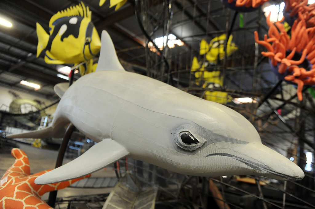 """. A dolphin on Sea Worlds entry titled \""""Dreams Come True\"""" for the upcoming 2014 Rose Parade at Fiesta Parade Floats in Irwindale, Calif. on Saturday, Sept. 7, 2013.   (Photo by Keith Birmingham/Pasadena Star-News)"""