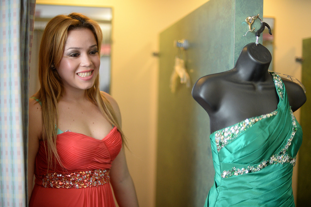 . Martha Cruz tries on a prom dress  at the Assistance League of Los Angeles in Hollywood Thursday, March 6, 2014. Operation School Bell Prom Day program outfitted 56 low-income and homeless high school girls from 17 LAUSD schools with dresses, shoes and other accessories so they can attend their proms.(Photo by Hans Gutknecht/Los Angeles Daily News)