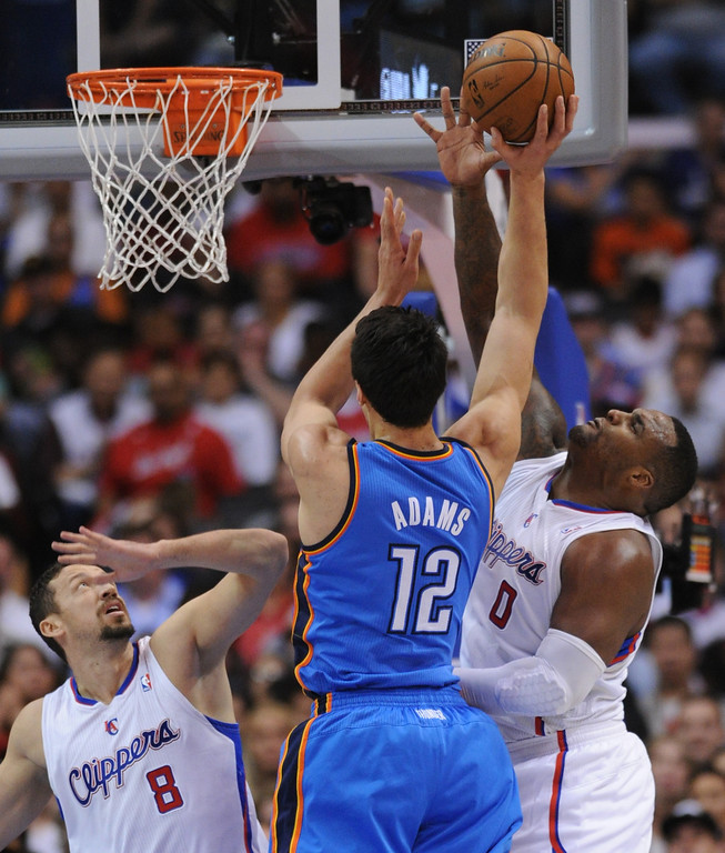 . Thunder#12 Steven Adams is fouled by Clippers#0 Glen Davis while Clippers#8 Hedo Turkoglu looks on in the 2nd quarter. The Los Angeles Clippers played the Oklahoma City Thunder in a regular season game at Staples Center in Los Angeles, CA. 4/9/2014(Photo by John McCoy / Los Angeles Daily News)