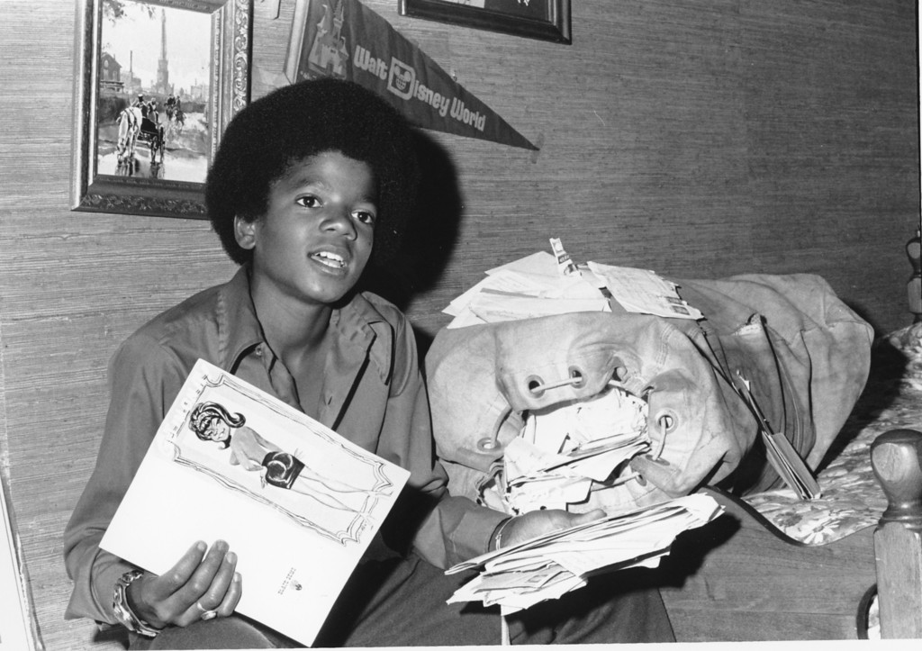 . Michael Jackson, who at 13 was  the  youngest member of the Jackson Five singing group, displays some of the cards and letters he receives from fans at his home in the San Fernando Valley suburb of Encino, Ca., in 1972. (AP Photo)