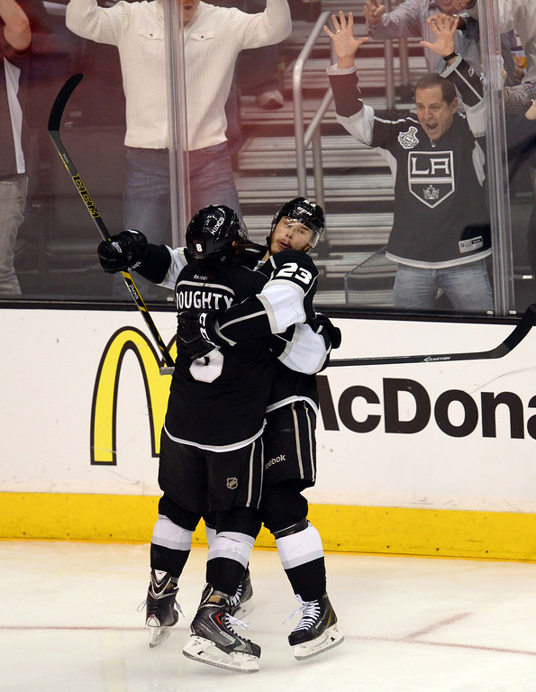 . The Kings� Dustin Brown #23 congratulates Drew Doughty #8 on his third period goal during Game 6 of the Western Conference finals at the Staples Center on Friday, May 30, 2014. The Blackhawks beat the Kings 4-3. (Photo by Hans Gutknecht/Los Angeles Daily News)