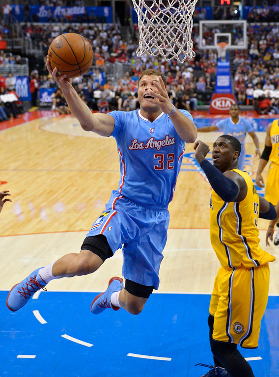 . Los Angeles Clippers forward Blake Griffin, left, puts up a shot as Indiana Pacers center Roy Hibbert defends during the first half of an NBA basketball game, Sunday, Dec. 1, 2013, in Los Angeles. (AP Photo/Mark J. Terrill)