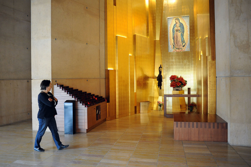 . A visitor passes by the chapel where a piece of Saint Juan Diego\'s famous cloak bearing the image of Our Lady of Guadalupe is displayed at the Cathedral of Our Lady of the Angels in Los Angeles, CA November 20, 2013.(Andy Holzman/Los Angeles Daily News)