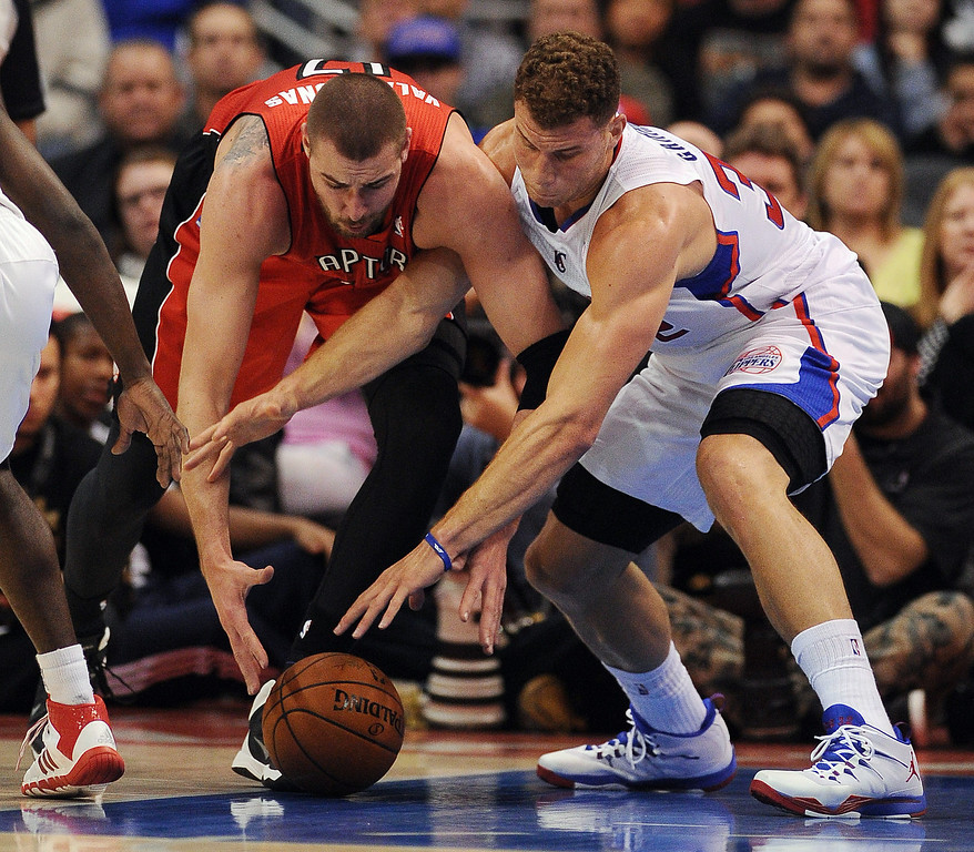 . The Clippers� Blake Griffin #32 and the Raptors� Jonas Valanciunas #17 battle for a loose ball during their game at the Staples Center in Los Angeles Friday, February 7, 2014. (Photo by Hans Gutknecht/Los Angeles Daily News)