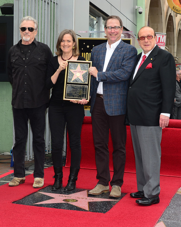 ". Siblings of the late Janis Joplin, Laura (2ndL) and Michael (2ndR), pose with Kris Kristofferson (L) who performed ""Me & Bobby McGee\"" for the crowd, and Clive Davis (R) pose on Janis\'s \'Star\' on November 4, 2013 in Hollywood, California. Joplin, who had her siblings Michael and Laura at the ceremony, would have turned 70 years old this year and is the recipient of the 2,510th Star on the Hollywood Walk of Fame in the Category of Recording.         (FREDERIC J. BROWN/AFP/Getty Images)"