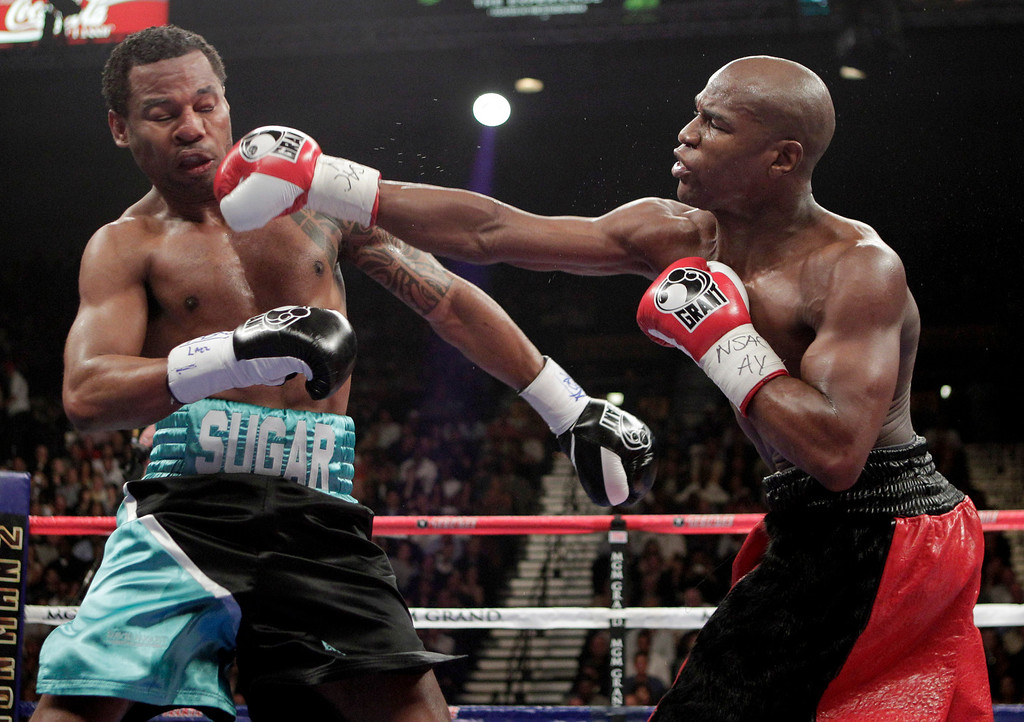 . Floyd Mayweather Jr., right, connects against Shane Mosley during their WBA welterweight boxing match Saturday, May 1, 2010, in Las Vegas. (AP Photo/Jae C. Hong)