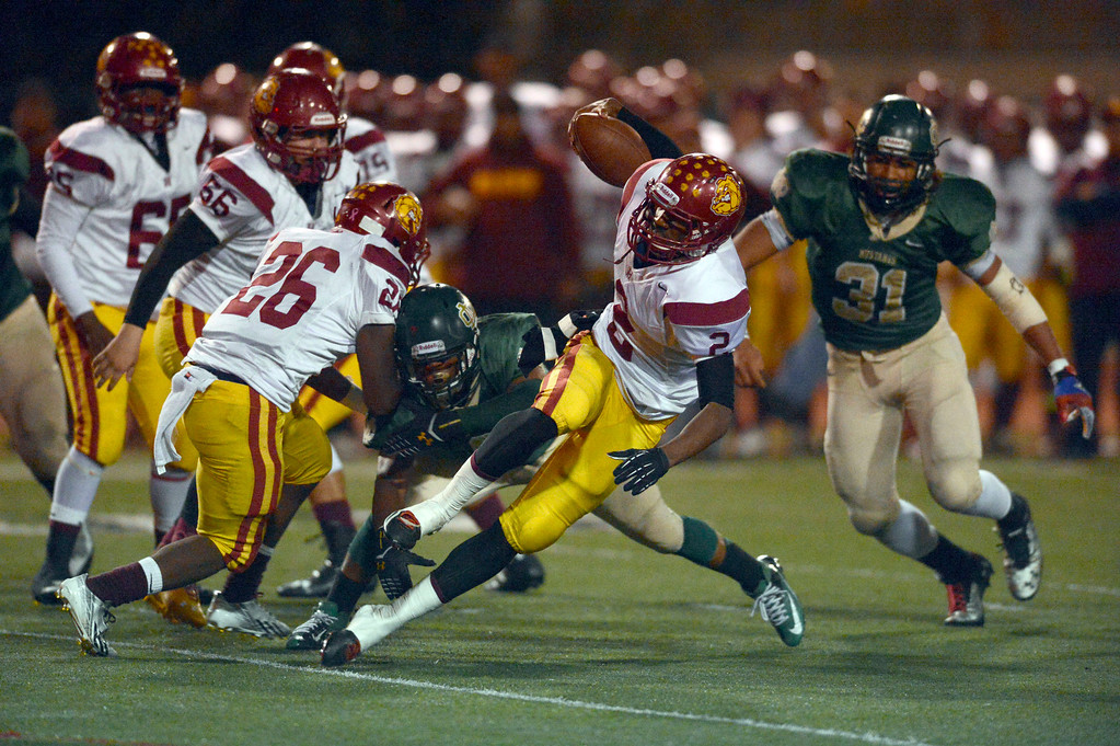 . Highland QB Donte Ross (2)  is pressured by the Costa defense in first-half game action in the CIF Southern Section Northern Division first-round football game between the Highland High School Bulldogs and Mira Costal Mustangs at Costa Friday evening, 11/15/2013.  Photo for The Daily Breeze by Axel Koester, 11/15/2013.