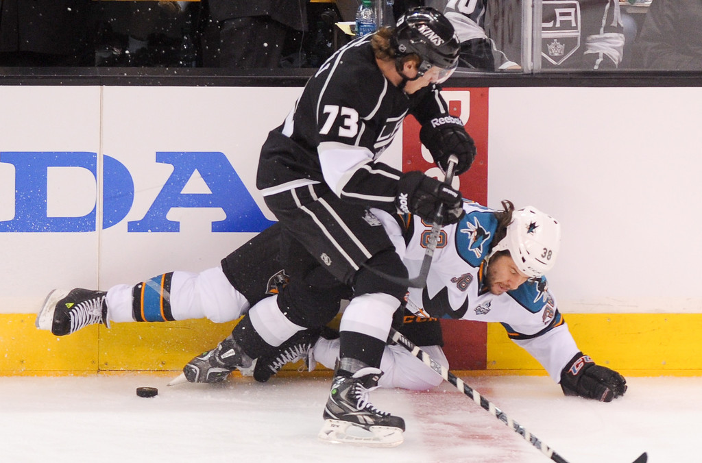 . Kings Tyler Toffoli checks the Sharks\' Bracken Kearns in the first period of game two of the second round of playoffs, Thursday, May 16, 2013, at Staples Center. (Michael Owen Baker/Staff Photographer)