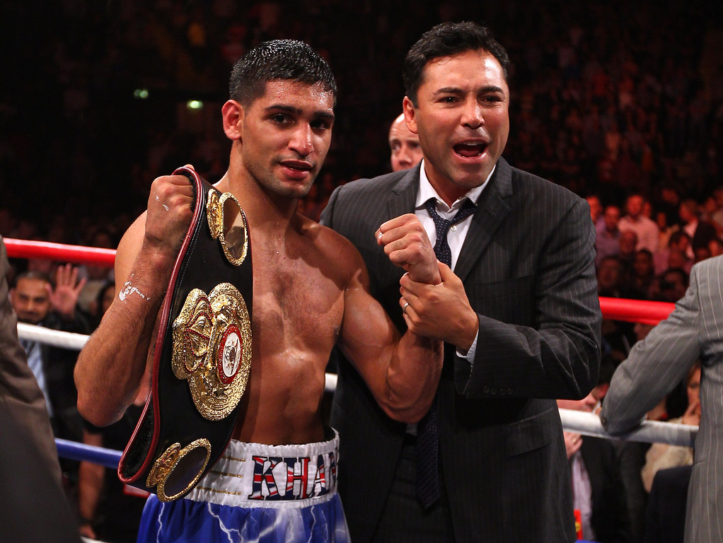 . MANCHESTER, ENGLAND - APRIL 16:  Amir Khan celebrates after with Oscar de la Hoya after victory over Paul McCloskey in the WBA Light-Welterweight Championship fight between Amir Khan and Paul McCloskey at MEN Arena on April 16, 2011 in Manchester, England.  (Photo by Alex Livesey/Getty Images)