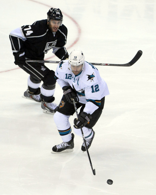 . San Jose Sharks center Patrick Marleau (12) controls the puck past Los Angeles Kings left wing Dwight King (74) during the first period in Game 4 of an NHL hockey first-round playoff series at Staples Center in Los Angeles on Thursday, April, 24  2014.  (Keith Birmingham Pasadena Star-News)