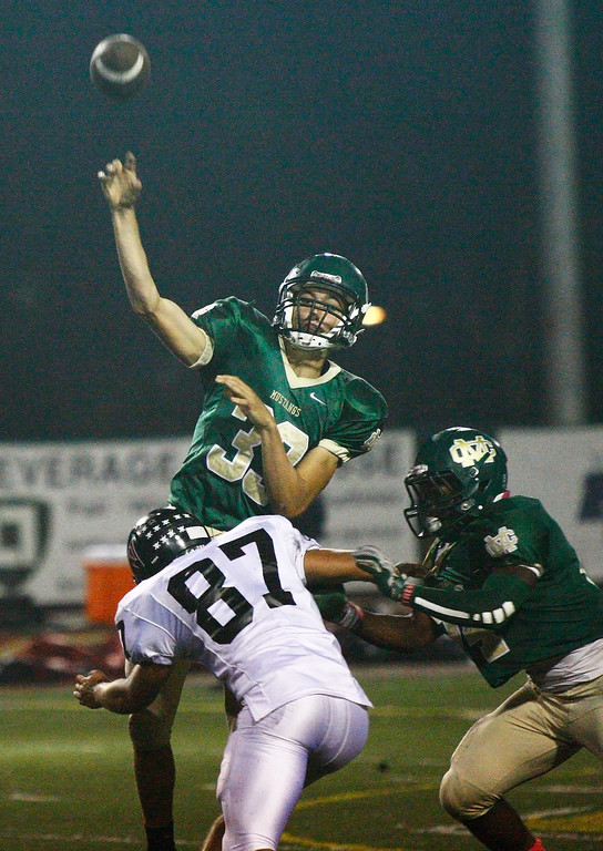 . Quarterback Greg Briskin #33 of Mira Costa throws the ball against the defense of Palos Verdes during a Bay League matchup at Mira Costa High School on Friday, October 18, 2013 in Manhattan Beach, Calif.  (Michael Yanow / For the Daily Breeze)