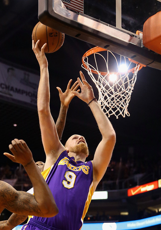 . Chris Kaman #9 of the Los Angeles Lakers puts up a shot against the Phoenix Suns during the NBA game at US Airways Center on January 15, 2014 in Phoenix, Arizona. The Suns defeated the Lakers 121-114.   (Photo by Christian Petersen/Getty Images)