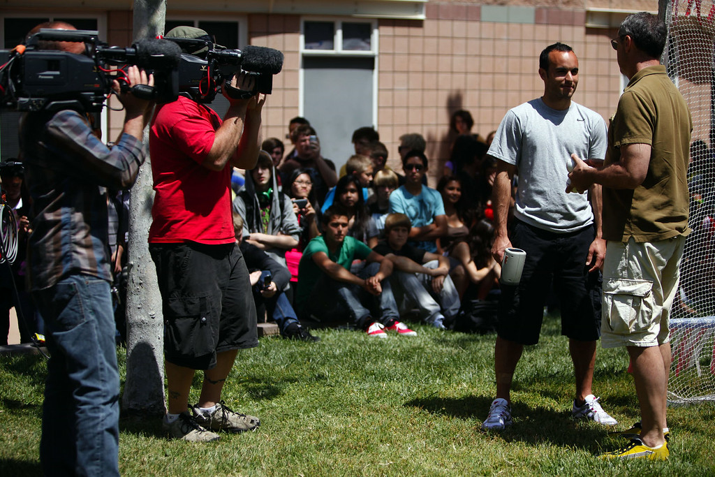 """. Landon Donovan chats with Rick Reilly, at Moore Middle School in Redlands where Donovan was a student, as they tape a segment for the ESPN show \""""Home Coming with Rick Reilly\"""" in Redlands Monday, April 19, 2010. Donovan, now a professional soccer player with the Los Angeles Galaxy, was a paper boy for the Redlands Daily Facts when he was a young teenager. (Staff file photo/Redlands Daily Facts)"""