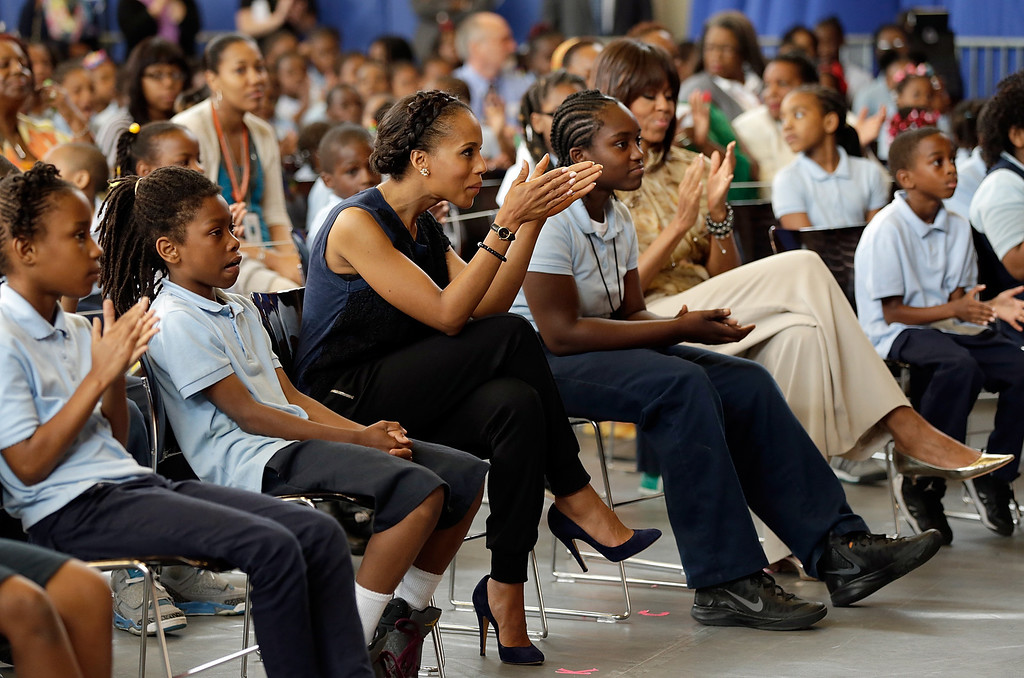 . WASHINGTON, DC - MAY 24:  Actress Kerry Washington sits with students during an event with U.S. first lady Michelle Obama (R) while visiting the Savoy School May 24, 2013 in Washington, DC. The Savoy School, once one of the lowest performing schools in the District of Columbia, has shown significant signs of improvement since being designated as one of eight schools selected last year for the Turnaround Arts Initiative by the President\'s Committee on the Arts and the Humanities.  (Photo by Win McNamee/Getty Images)