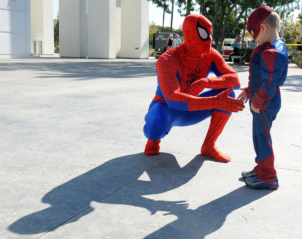 . (Will Lester/Inland Valley Daily Bulletin) Spiderman greets Jacob Long before they both teammed up to hunt down a villian in the Ontario Convention Center Thursday. Jacob Long, 5 from Mira Loma, dream of fighting along side his favorite superhero, Spiderman, came true Thursday August 22, 2013 by the Make-A-Wish Orange County/Inland Empire along with assistance from the Ontario police and fire departments. At 15 months Jacob was diagnosed with an immune deficiency disease and has had to have 2 bone marrow transplants to cure it.