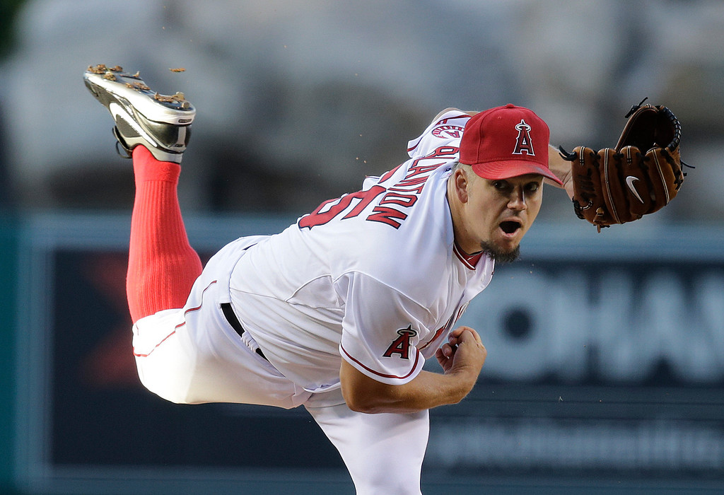 . Los Angeles Angels starting pitcher Joe Blanton throws against the Seattle Mariners during the first inning of a baseball game in Anaheim, Calif., Tuesday, June 18, 2013. (AP Photo/Jae C. Hong)