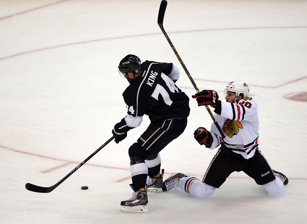 . The Kings� Dwight King #74 gets past the Brandon Saad #20 on his way to the goal during Game 6 of the Western Conference finals at the Staples Center on Friday, May 30, 2014. (Photo by Hans Gutknecht/Los Angeles Daily News)