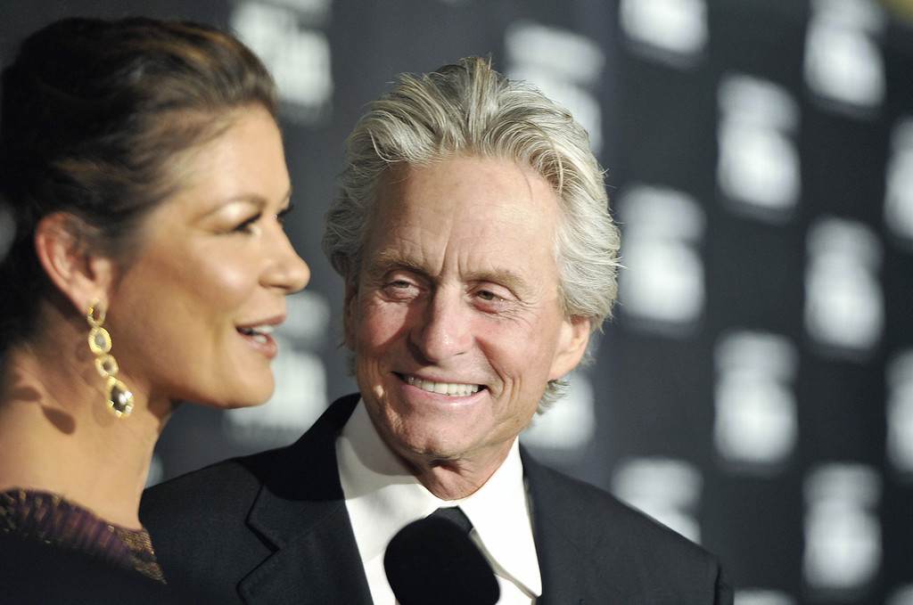 . Actor Michael Douglas arrives with Catherine Zeta-Jones at the Santa Barbara International Film Festival black-tie gala fundraiser at the Biltmore in Santa Barbara, Calif., on Thursday Oct. 13, 2011. Michael Douglas will receive the Kirk Douglas Award for Excellence in Film. (AP Photo/Phil Klein)