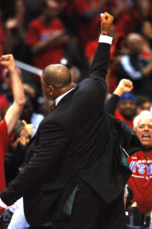 . Clippers coach Doc Rivers celebrates with the fans after beating the Warriors. (Photo by Michael Owen Baker/L.A. Daily News)