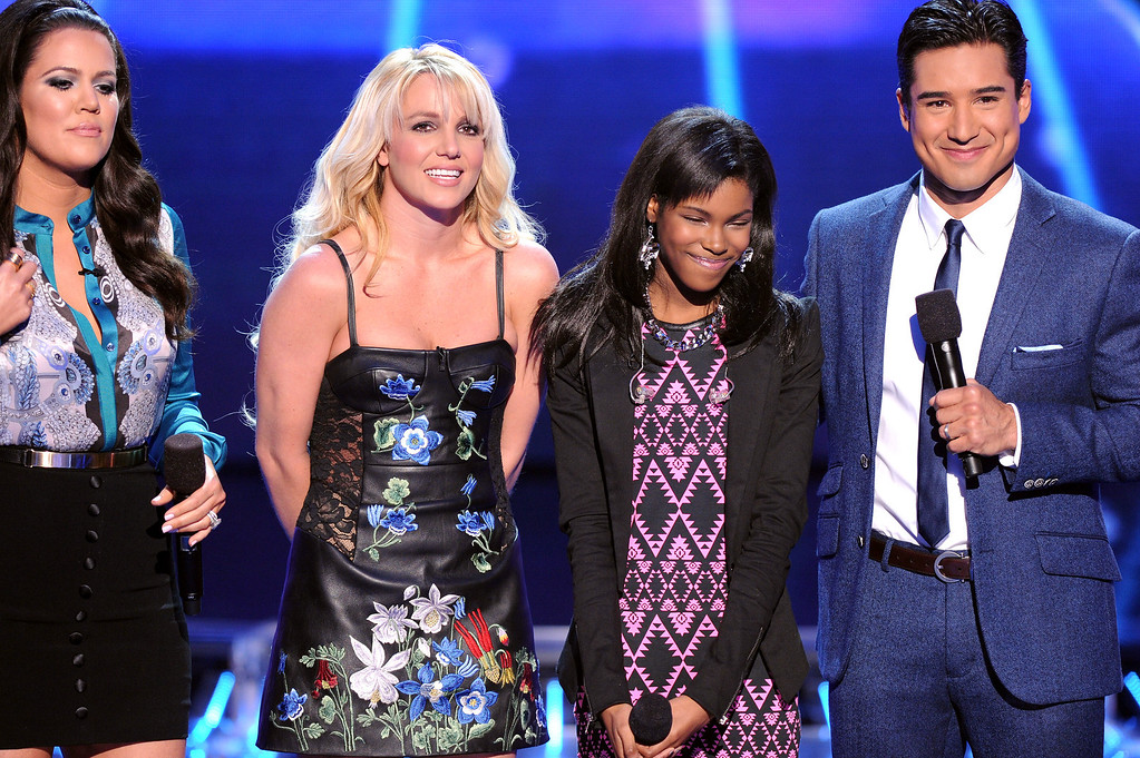 ". HOLLYWOOD, CA - DECEMBER 6: (L-R) Host Khloe Kardashian Odom, judge Britney Spears, eliminated contestant Diamond White and host Mario Lopez onstage at FOX\'s ""The X Factor\"" Season 2 Top 6 to 4 Live Elimination Show on December 6, 2012 in Hollywood, California. (Photo by Frank Micelotta/PictureGroup) via AP IMAGES"