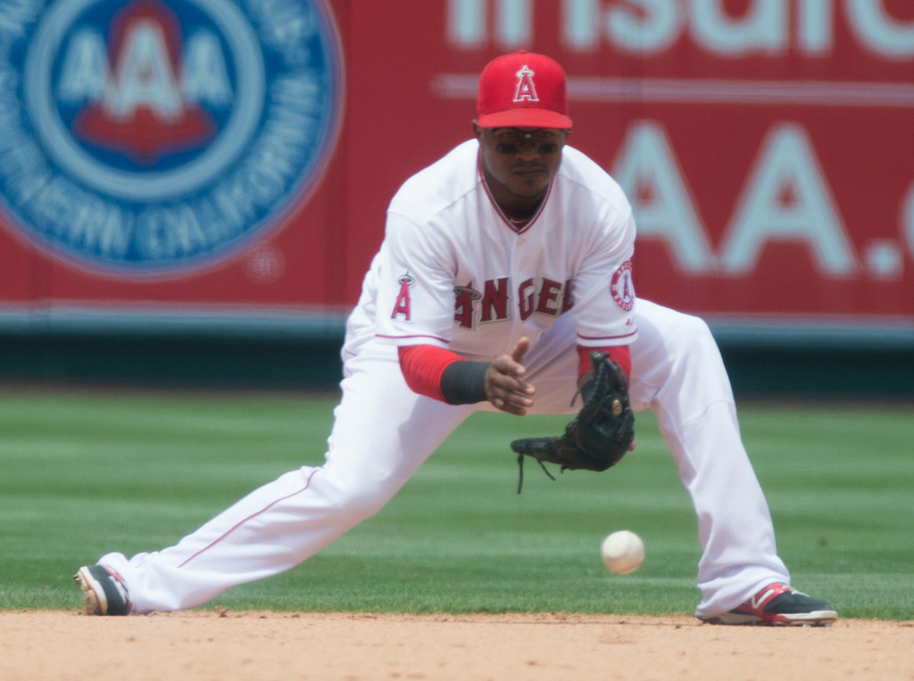 . Angels shortstop Erick Aybar (#2) fields a ball as they play tthe Minnesota Twins at Angel Stadium in Anaheim on Thursday June 26, 2014. (Photo by Keith Durflinger/Whittier Daily News)