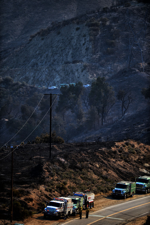. Firefighters along an along San Francisquito Canyon in an area burned by the Powerhouse brush fire near Green Valley Friday, May 31, 2013. (Hans Gutknecht/Los Angeles Daiy News)