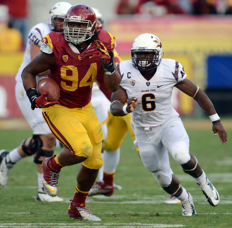 . USC\'s Leonard Williams #94 runs up field after intercepting a pass during their PAC 12 Conference game against Arizona State at the Los Angeles Memorial Coliseum Saturday, November 10th 2012. USC beat Arizona State 38-17. (Hans Gutknecht/L.A. Daily News)