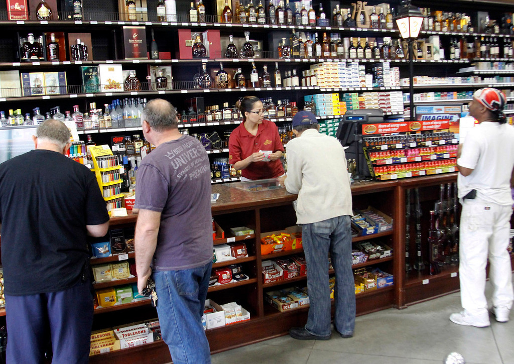 . Customers choose their numbers and buy Powerball tickets, a jackpot worth $600 milion, at Mission Liquor Store in Pasadena, Friday, May 17, 2013. (Correspondent Photo by James Carbone/SXCITY)