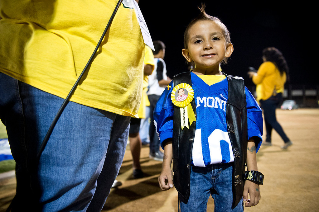 . Five-year-old Doryan Torres is honored during the El Monte High School football halftime special in El Monte on Friday night, Sept. 13, 2013. Torres who is turning 6 on Saturday, has been battling a brain tumor since he was 14 months old. (Photo by Watchara Phomicinda/ San Gabriel Valley Tribune)
