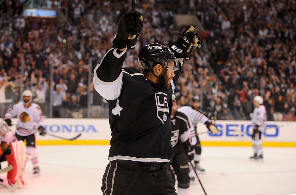 . The Kings\' Dwight King celebrates his first period goal against the Blackhawks during game six of the Western Conference Finals, Friday, May 30, 2014, at Staples Center. (Photo by Michael Owen Baker/Los Angeles Daily News)