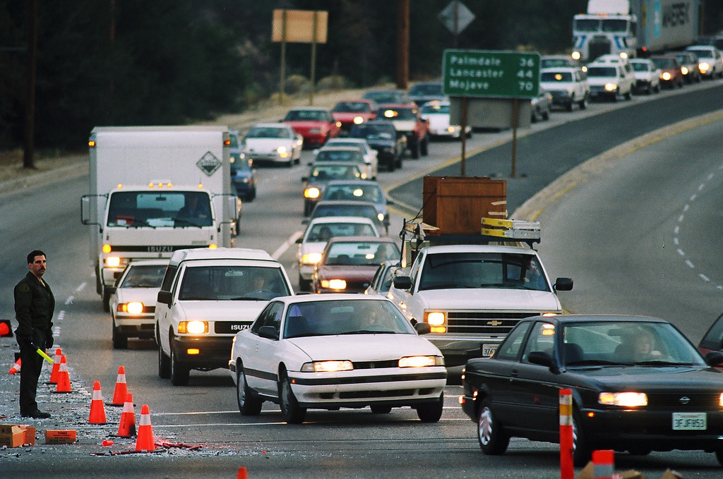. Frustrated commuters limped along Sierra Hwy. near San Fernando Rd. as they try to bypass damaged freeways following the Northridge earthquake.   1/19/94  (David Crane/Los Angeles Daily News)