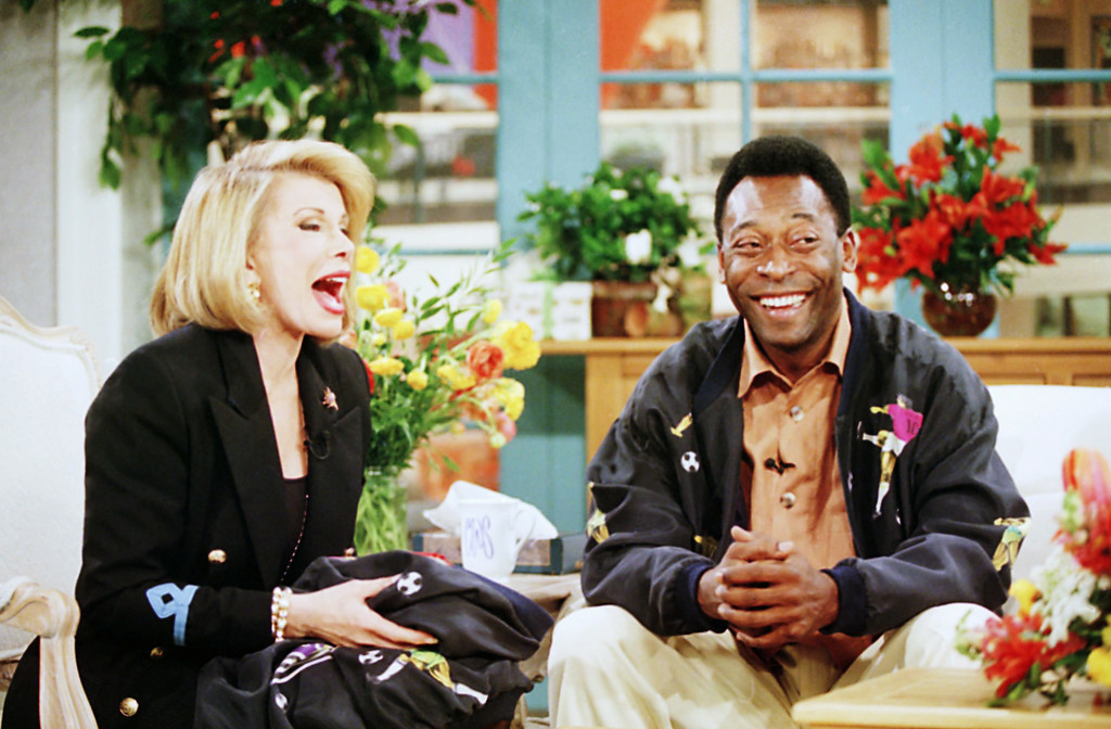 . Joan Rivers interviews soccer legend Pele on her syndicated talk show ?Can We Shop? in New York on Thursday, April 21, 1994. During the taping Pele, 53, confirmed rumors that he will wed Assiria, 33, a fellow Brazilian, at the end of April.  The show is scheduled to air on May 10, 1994. (AP Photo/Monika Graff)
