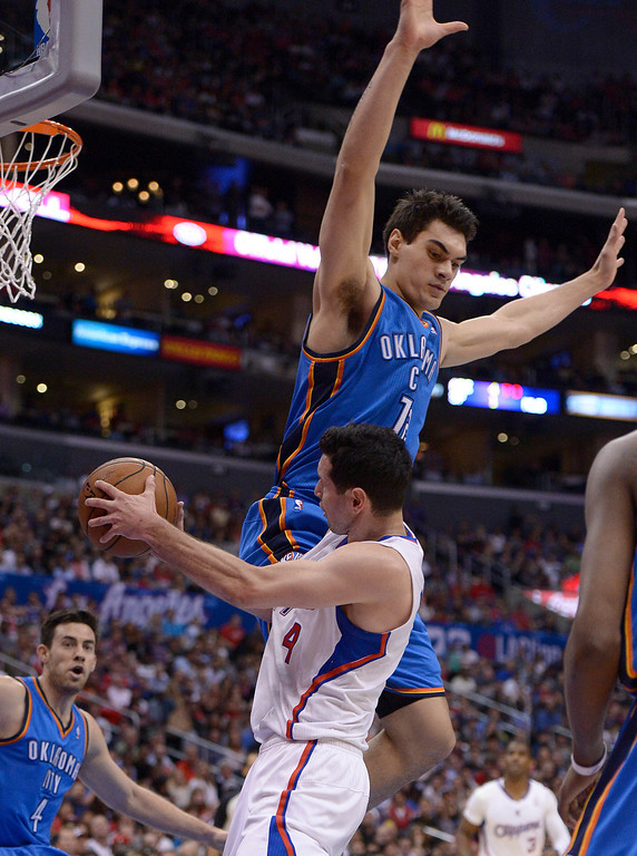 . Clippers#4 J.J. Redick gets fouled by Thunder#12 Steven Adams in the first half.  The Los Angeles Clippers played the Oklahoma City Thunder in a regular season game at Staples Center in Los Angeles, CA. 4/9/2014(Photo by John McCoy / Los Angeles Daily News)