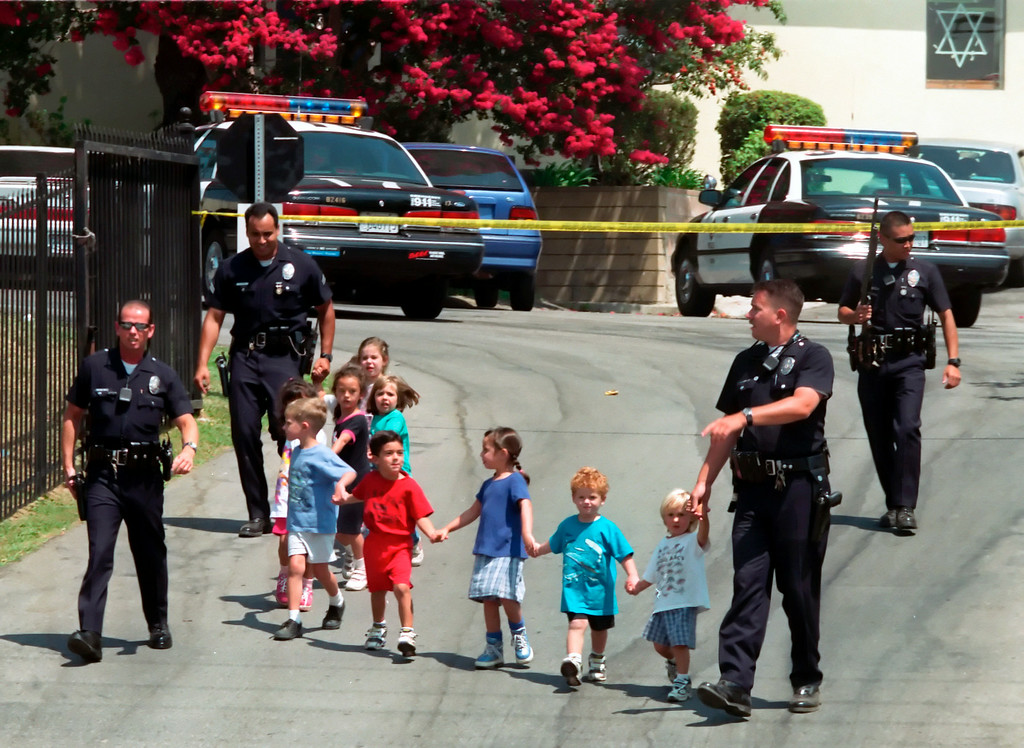 . 15 years ago on August 10, 1999, Los Angeles Police Officers lead children to safety after Buford O. Furrow, Jr. walked into the lobby of the North Valley Jewish Community Center in Granada Hills and opened fire with a semiautomatic weapon. The gunfire wounded five people: three children, a teenage counselor, and an office worker. After leaving the  North Valley Jewish Community Center Furrow murdered US Postal Service carrier Joseph Ileto nearby.  On January 24, 2001 Furrow pleaded guilty to avoid a possible death sentence, and was sentenced to life in prison without the possibility of parole. (Hans Gutknecht/Los Angeles Daily News)