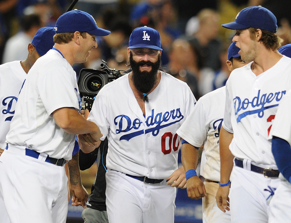 . Dodgers #13 Chris Denorfia congratulates Brian Wilson and he runs out onto the field with Clayton Kershaw at the end of the game. The Dodgers defeated the San Diego Padres 2-1 in a game at Dodger Stadium in Los Angeles, CA. 8/31/2013  (John McCoy/LA Daily News)