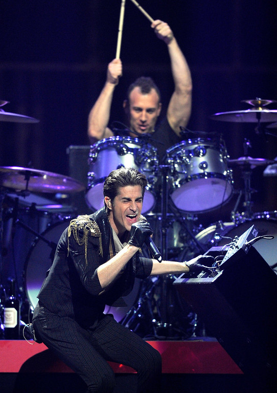 . LAS VEGAS, NV - SEPTEMBER 23:  Singer Perry Farrell and drummer Stephen Perkins of the band Jane\'s Addiction perform onstage at the iHeartRadio Music Festival held at the MGM Grand Garden Arena on September 23, 2011 in Las Vegas, Nevada.  (Photo by Ethan Miller/Getty Images for Clear Channel)