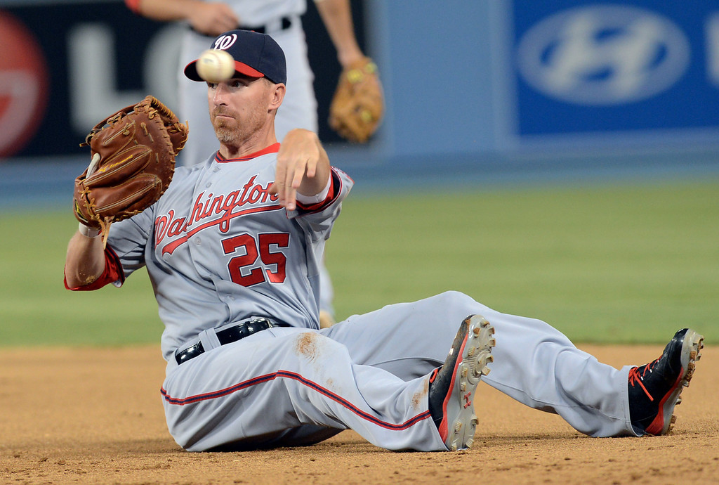. Adam LaRoche of the Washington Nationals completes a throw to first for an out against the Dodgers in Los Angeles, CA May 13, 2013.(Andy Holzman/Staff Photographer)