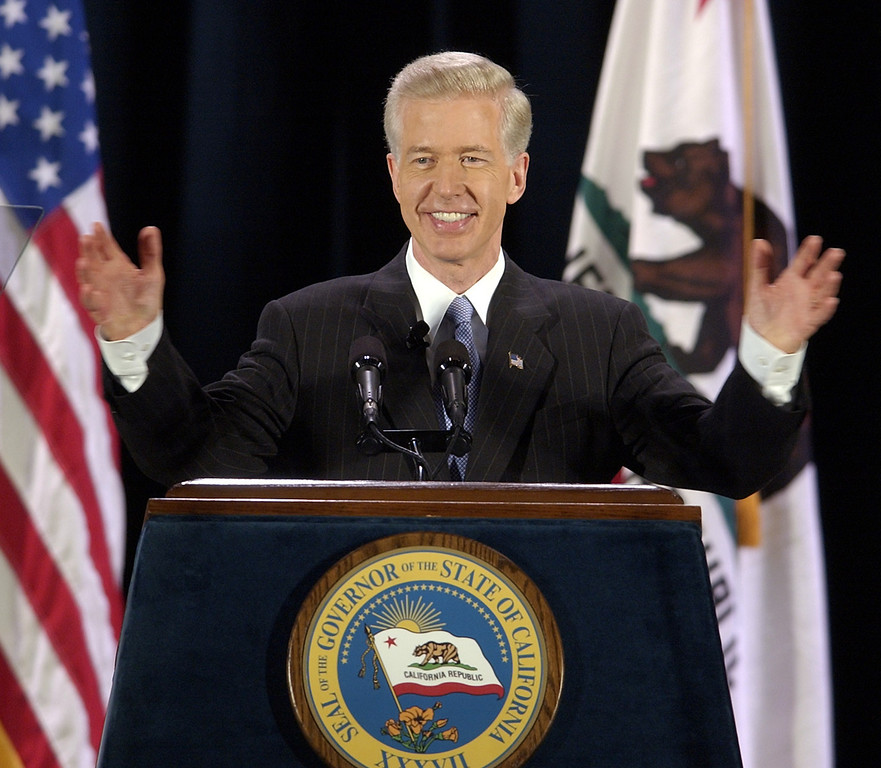 """. California Gov. Gray Davis waves his hands to a chorus of \""""no recall\"""" from the gathered crowd as he begins his first major address on the recall election aimed at removing him from office, Tuesday, Aug. 19, 2003, on the campus of UCLA in Los Angeles. (AP Photo/Reed Saxon)"""