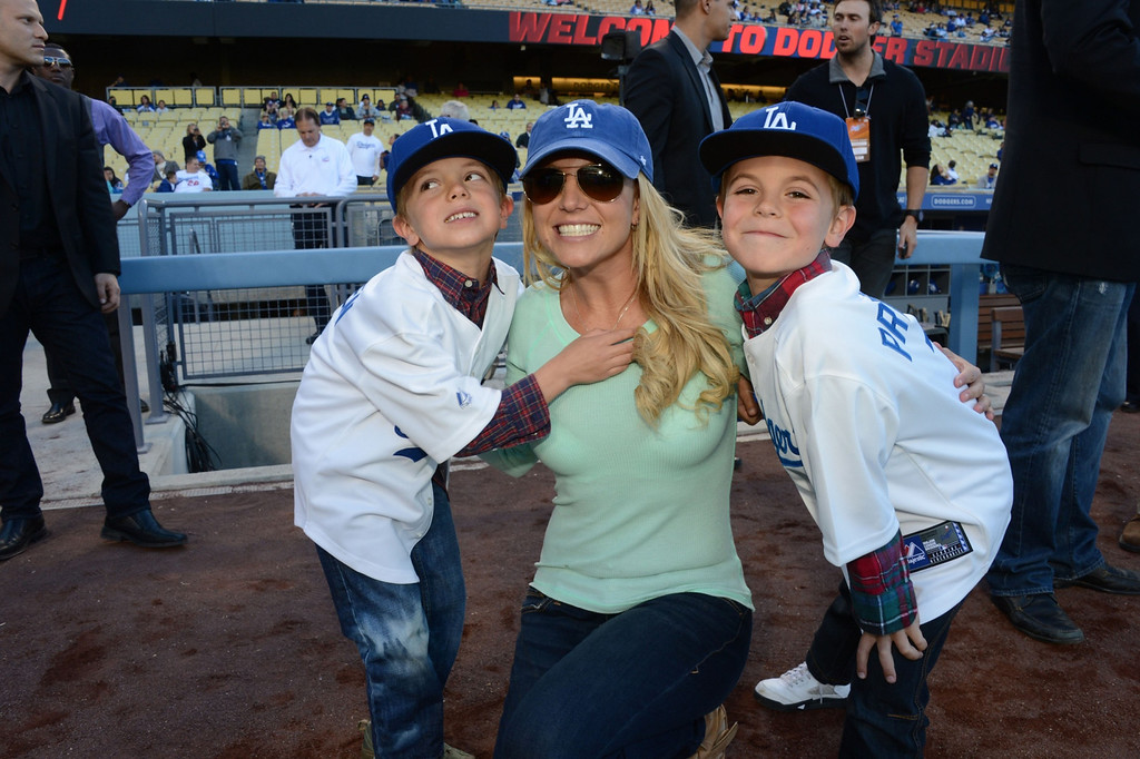 . In this handout photo provided by the LA Dodgers, Britney Spears poses with sons Jayden James Federline (L) and Sean Preston Federline (R) during a game against the San Diego Padres at Dodger Stadium on April 17, 2013 in Los Angeles, California. (Photo by Jon SooHoo/LA Dodgers via Getty Images)