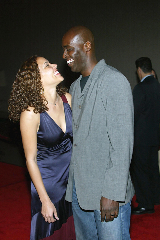 """. Actor Michael Jace (R) and  April attend the third season premiere screening of \""""The Shield\"""" at the Zanuck Theater on March 8, 2004 in Los Angeles, California. The series \""""The Shield\"""" will premiere on the FX Network on March 9, 2004.  (Photo by Frederick M. Brown/Getty Images)"""
