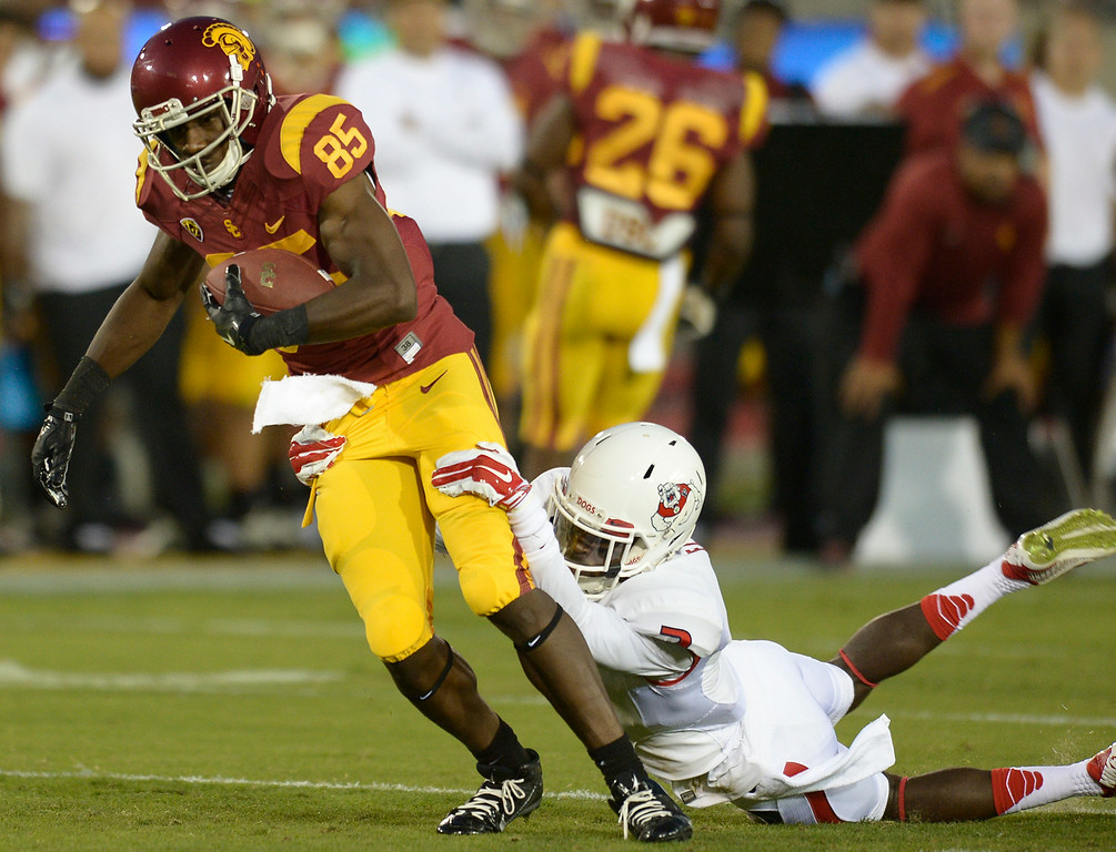 . USC #85 Victor Blackwell is brought down by Fresno #2 Jamal Ellis in the 4th quarter.  USC defeated Fresno State 52-13 at the Los Angeles Memorial Coliseum. Los Angeles, CA. 8/30/2014(Photo by John McCoy Daily News