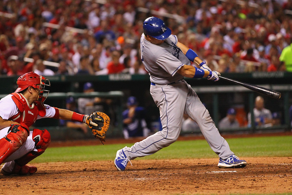 . A.J. Ellis #17 of the Los Angeles Dodgers hits a three-run home run against the St. Louis Cardinals in the fifth inning at Busch Stadium on August 8, 2013 in St. Louis, Missouri.  Dodgers won 5-1.   (Photo by Dilip Vishwanat/Getty Images)