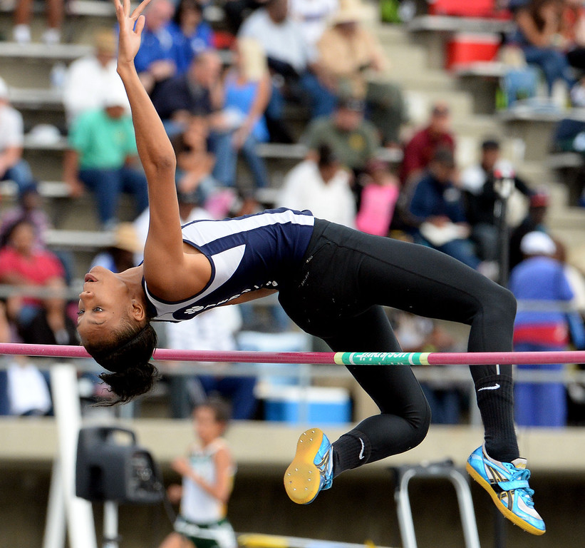 . Redland\'s Savannah Miller competes in the division 2 high jump during the CIF Southern Section track and final Championships at Cerritos College in Norwalk, Calif., Saturday, May 24, 2014. 
