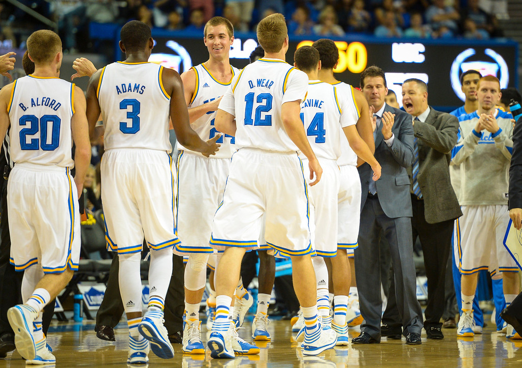 . UCLA players congratulate each other as they go up by more than 20 points over USC during game action at Pauley Pavilion Sunday, December 5, 2014. UCLA  defeated USC 107-73.  Photo by David Crane/Los Angeles Daily News.